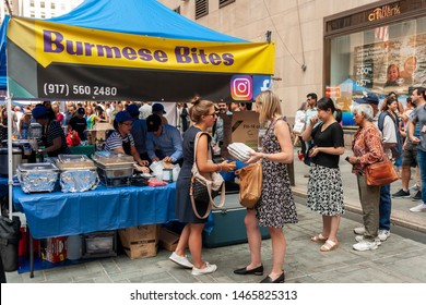 New York NY/USA-July 30, 2019 Tourists and office workers flock to Burmese Bites in The Outpost of the Queens Night Market, located in Rockefeller Plaza