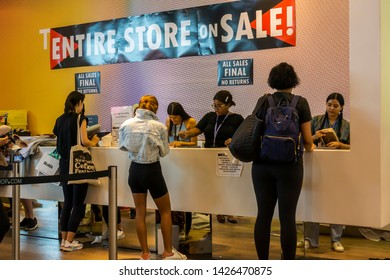 New York NY/USA-June 15, 2019 Shoppers pay for their purchases at the TopShop/TopMan store in Soho in New York