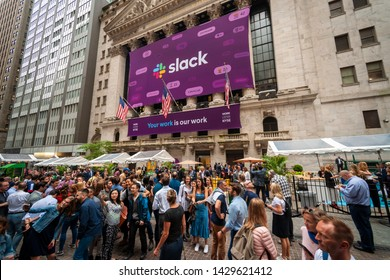 New York NY/USA-June 20, 2019 Slack employees and tourists mingle in front of the New York Stock Exchange decorated for the first day of trading for the workplace messaging company Slack