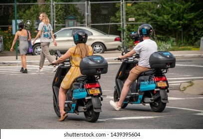 New York NY/USA-June 29, 2019 Riders travel on an electric moped from the moped sharing company Revel in the Red Hook neighborhood of Brooklyn in New York