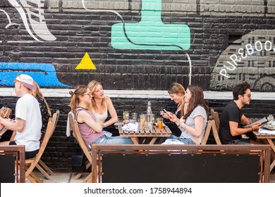 New York NY/USA-June 3, 2017 Al fresco brunch in Bushwick, Brooklyn in New York during the annual Bushwick Collective Block Party