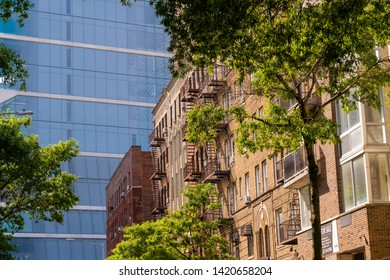 New York NY/USA-June 8, 2019 Dichotomy between new construction and pre-war apartment buildings with fire escapes in the Washington Heights neighborhood of New York