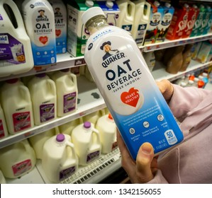 New York NY/USA-March 16, 2019 A discerning consumer chooses a container of Quaker brand oat-beverage in the milk cooler in a supermarket