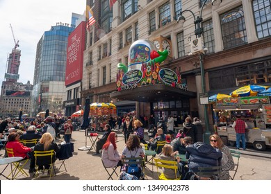 New York NY/USA-March 24,2019 Hordes of visitors in Macy's flagship department store in Herald Square which is festooned with floral arrangements for the annual Macy's Flower Show