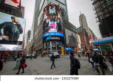 New York NY/USA-March 29, 2019 The giant video screen on the Nasdaq stock exchange in Times Square is decorated for the debut of the Lyft ride-sharing service initial public offering