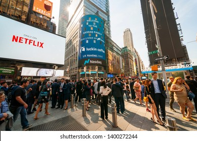 New York NY/USA-May 17, 2019 Luckin Coffee executives and their families and friends in front of the Nasdaq stock exchange in Times Square decorated for the debut of the their initial public