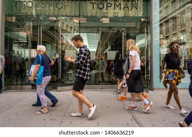 New York NY/USA-May 24, 2019 Shoppers pass the TopShop store on Fifth Avenue in New York