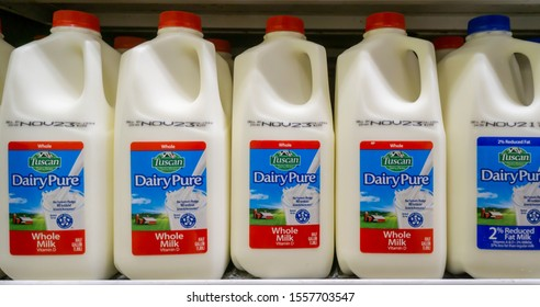 New York NY/USA-November 12, 2019 Containers of Dean FoodsÕ Tuscan Dairy Pure milk, in a supermarket cooler in New York