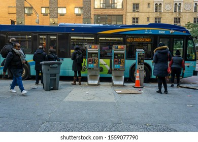 New York NY/USA-November 13, 2019 Passengers celebrate the arrival of a Select Bus Service bus on the M23 route in Chelsea in New York