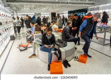 New York NY/USA-November 17, 2018 Shoppers try on sneakers in the newly opened Nike flagship store on Fifth Avenue in New York
