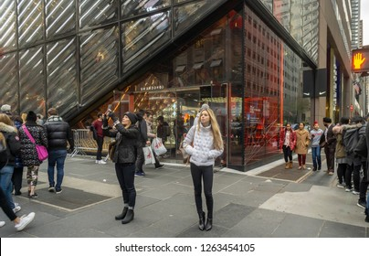 New York NY/USA-November 17, 2018 Shoppers and visitors outside the newly opened Nike flagship store on Fifth avenue in New York