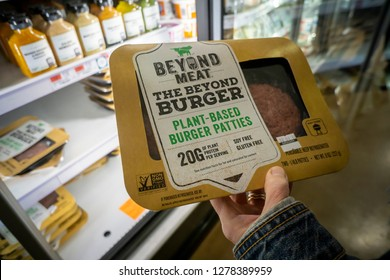 New York NY/USA-November 19, 2018 A shopper chooses a package of Beyond Meat from a freezer in a supermarket in New York on Monday, November 19, 2018.