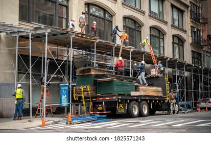 New York NY/USA-October 1, 2020 Workers form a human chain to construct scaffolding in the Flatiron neighborhood of New York