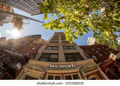 New York NY/USA-October 19, 2019 Signs announce the location of a WeWork co-working space location in Manhattan in New York