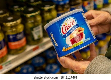 New York NY/USA-October 27, 2020 A shopper chooses a can of J.M.Smucker Co.Õs Crisco brand all-vegetable shortening in a supermarket