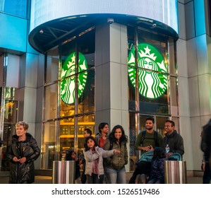 New York NY/USA-October 8, 2019 Passer-by walk past a Starbucks coffee shop in Midtown Manhattan in New York
