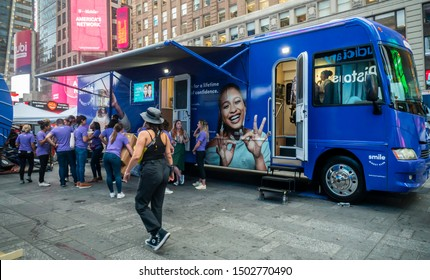 New York NY/USA-September 12, 2019 Workers for the SmileDirectClub pack up their branding event in Times Square in New York on the day of their initial public offering on Nasdaq