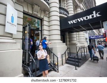 New York NY/USA-September 15, 2017 A busy Blue Bottle Coffee shop located next to a WeWork co-working space in New York