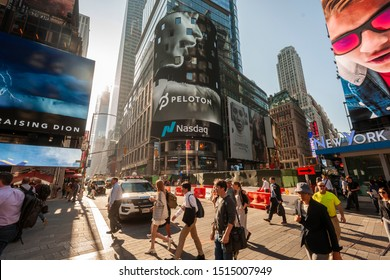 New York NY/USA-September 26, 2019 The display on the Nasdaq stock exchange in Times Square displays video for the initial public offering of the at-home fitness company company Peloton Interactive