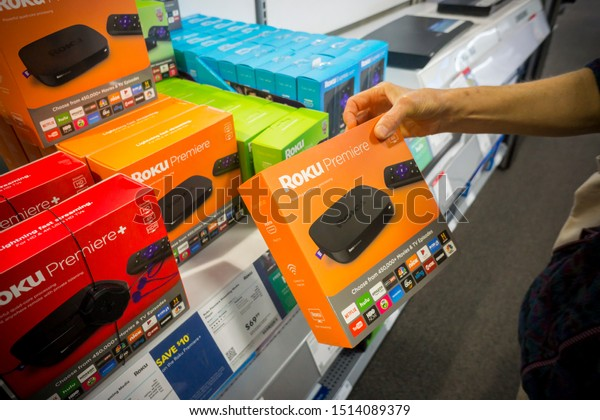 New York NY//USA-September 3, 2017 A shopper chooses a Roku video-streaming product on display in a Best Buy store in New York