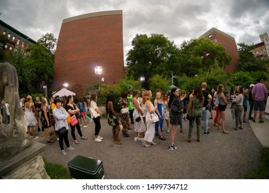 New York NY/USA-September 7, 2019 Fashionistas and the common public wait on line for ice cream after the Kate Spade New York Fashion Week show in the Elizabeth Street Garden in Nolita in New York