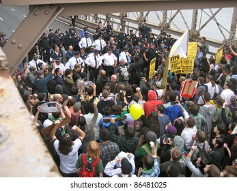NEW YORK - OCT 1: Police confront a group of protesters on the roadway of the Brooklyn Bridge, October 1, 2011 in New York City. Hundreds of people were arrested at an Occupy Wall Street march.