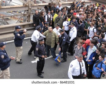 NEW YORK - OCT 1: Police arrest an unidentified man on the roadway of the Brooklyn Bridge, October 1, 2011 in New York City. Hundreds of people were arrested at an Occupy Wall Street protest march.