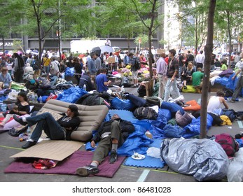 NEW YORK - OCT 11: Unidentified Occupy Wall Street protesters camp out in Zuccotti Park, Lower Manhattan, on October 11, 2011 in New York City. The protest started September 17.