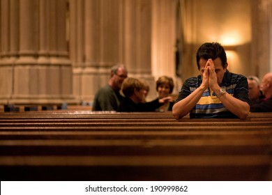 NEW YORK - OCT 20: Man prays at St Patrick's Cathedral on October 20, 2011 in New York City. The Cathedral will undergo a massive five-year, three-phase, $175 million renovation