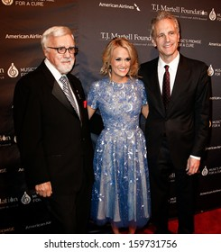NEW YORK- OCT 22: (L-R) Tony Martell, Carrie Underwood  and John Sykes attend the T.J. Martell Foundation's 38th Annual Honors Gala at Cipriani's on October 22, 2013 in New York City.