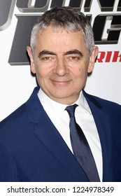"NEW YORK - OCT 23, 2018: Rowan Atkinson attends the premiere of ""Johnny English Strikes Again"" at the AMC Lincoln Square Theater on October 23, 2018 in New York City."