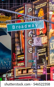 NEW YORK, NEW YORK - OCT 29: Broadway street sign backed by advertisements  in Times Square in New York City on October 29, 2012. Broadway is generally renowned as the captial of theatre.