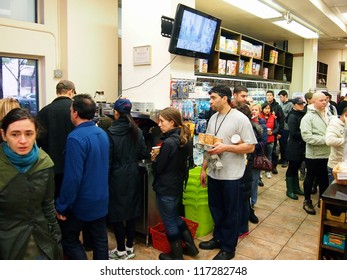 NEW YORK - OCT 30 2012: New Yorkers stand in a long line for coffee and supplies at one of the only open stores in Battery Park City, New York City, NY. Superstorm Sandy shut down much of the city.