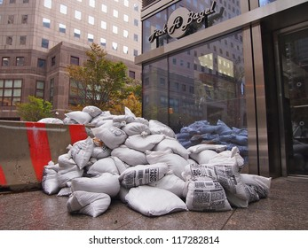 NEW YORK - OCT 30: Sandbags protect the entrance to a bagel shop in Lower Manhattan on October 30, 2012 in New York City, NY. Superstorm Sandy shut down much of the city.