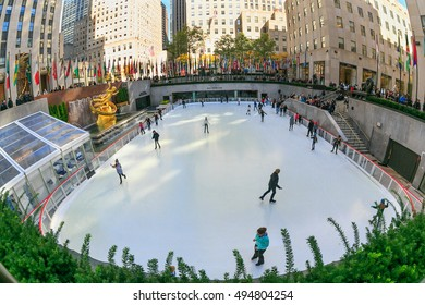 NEW YORK - OCT 31: People enjoy skating at Lower Plaza with ice-skating rink, Rockefeller Center on Oct 31, 2015 in New York, USA.