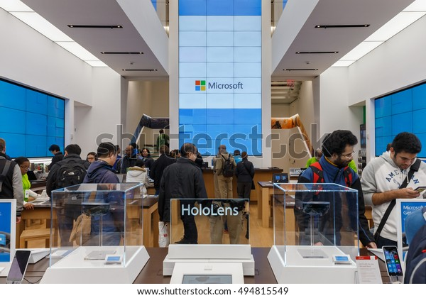 NEW YORK - OCT 31: People visit Microsoft Store at Fifth Avenue on Oct 31, 2015 in New York. Its best known software products are the Microsoft Windows line of operating systems.