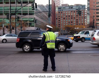 NEW YORK - OCT 31: A police officer directs traffic on West Street where a signal is out on October 31, 2012 in New York City, NY. Superstorm Sandy shut down much of the city.