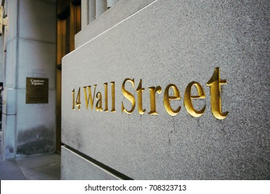 NEW YORK; OCT 5: Wall street sign in financial district in new york on 5 october 2014. wall street is a metonymy for the financial markets of the United States which is street in Lower Manhattan