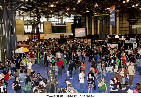 NEW YORK - OCTOBER 09: Convention floor. Convention goers attend the 2010 New York Comic Con at the Jacob Javits Center on October 9, 2010 in NYC.