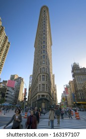 NEW YORK, October 15, 2013: Flatiron Buidling, New York City (with busy crowd on the street)