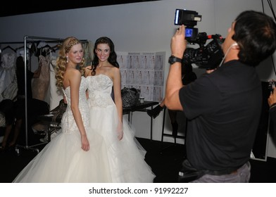 NEW YORK - OCTOBER 17: Model posing for videographer backstage at the Winnie Couture Bridal Collection for Spring/ Summer 2012 during NY Bridal Fashion Week on October 17, 2011 in New York, USA