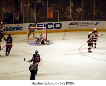 NEW YORK - OCTOBER 2: The Rangers score a goal on Devils goalie Martin Brodeur  in a preseason game at Madison Square Garden October 2, 2005 in New York, NY.