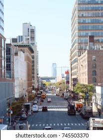 NEW YORK - OCTOBER 20, 2017: View down 11th Avenue in Manhattan, from the High Line. Traffic travels down the street towards Chelsea. The Goldman Sachs building in New Jersey stands in the distance.