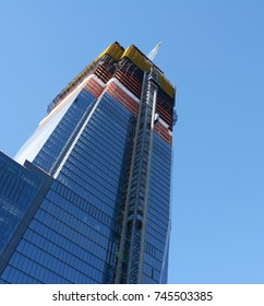 NEW YORK - OCTOBER 20, 2017: Skyscraper under construction at Hudson Yards. Lower floors of tower block are glazed, while the upper floors of the building in Manhattan are still under construction.