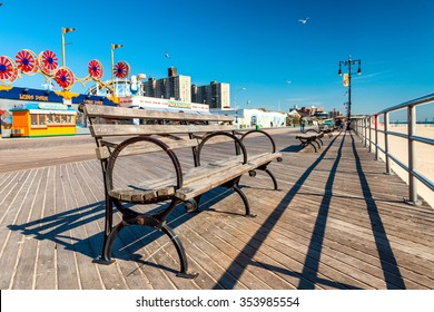NEW YORK - OCTOBER 20: Coney Island boardwalk in front of the Wonder wheel on October 20, 2015 in Coney Island, NY. Coney Island is a famous tourist attraction.