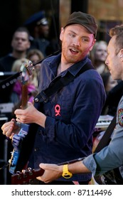 NEW YORK - OCTOBER 21: Coldplay performs live for the Toyota Concert Series on NBC's Today Show at Rockefeller Plaza on October 21, 2011 in New York City.