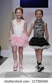 NEW YORK - OCTOBER 21: Girls walk runway petite Parade by Ooh! La, La! Couture during kids fashion week sponsored by Vogue Bambini, Swarovski Elements at Industria Superstudio on Oct 20, 2012 in NYC