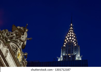 NEW YORK - OCTOBER 22:  A night time view of The Glory of Commerce sculpture adorning Grand Central Station, New York City on October 22, 2017.  In the background is the Chrysler Building.