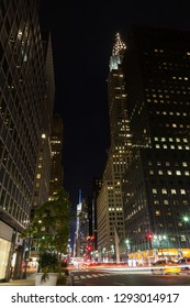 NEW YORK - OCTOBER 22:  The view along 42nd Street, New York City on October 22, 2017.  The Chrysler Building can be seen at night standing above the neighbouring buildings.