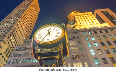 NEW YORK - OCTOBER 23, 2015. The Trump Tower on Fifth Avenue and its clock at night, typical of the high-end mixed use skyscrapers common in Manhattan which combine both commercial and residential use
